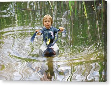 Cute Tiny Boy Riding A Duck Canvas Print by Jaroslaw Grudzinski