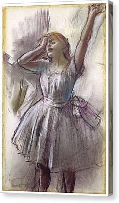 Dancer Stretching Canvas Print by Edgar Degas