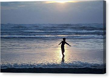 Dancing Boy At Sunset Canvas Print by Peter Mooyman