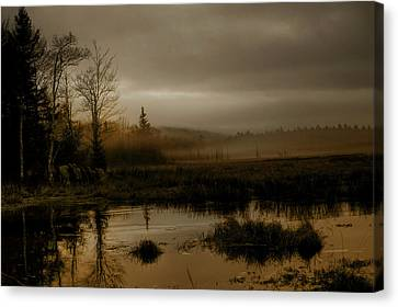 Darkness Approaches Canvas Print by Greg DeBeck