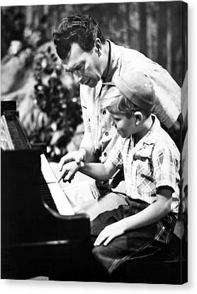 Dave Brubeck And Teaching His Son Canvas Print by Everett