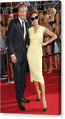 David Beckham, Victoria Beckham Wearing Canvas Print by Everett