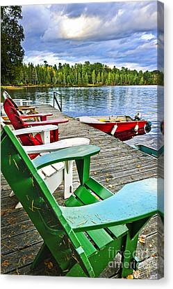Deck Chairs On Dock At Lake Canvas Print by Elena Elisseeva