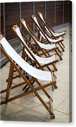 Deckchairs Canvas Print by Carlos Caetano