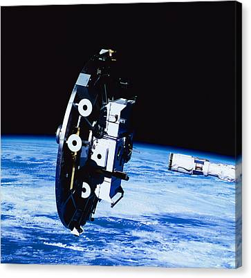 Deployment Of A Satellite In Space Canvas Print by Stockbyte