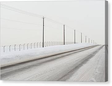 Desolate Winter Road Canvas Print by Lynn Koenig