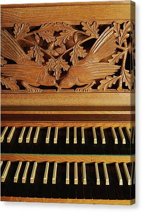 Detail Of A Pipe Organ With A Wooden Carving Canvas Print by Gregor Hohenberg
