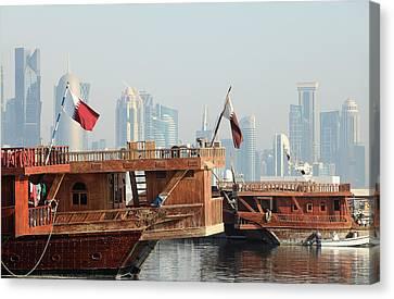 Dhows And Doha Skyline Canvas Print by Paul Cowan