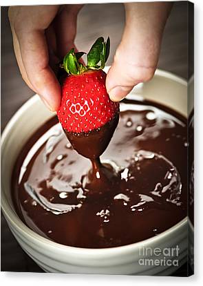 Rich Canvas Print - Dipping Strawberry In Chocolate by Elena Elisseeva