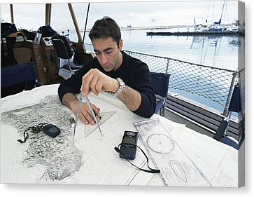 Diver Plotting A Course Canvas Print by Alexis Rosenfeld