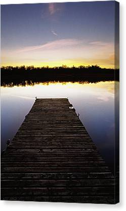 Dock At Sunset Canvas Print by Gareth McCormack