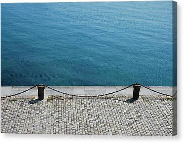 Dock Chain By Pavement Canvas Print by Photography by Kévin Niglaut