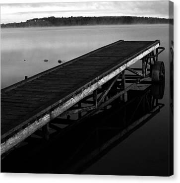 Dock Canvas Print by Jerry Cordeiro