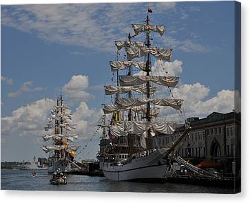 Docked At Fish Pier Canvas Print by Mike Martin
