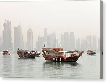 Doha In The Mist Canvas Print by Paul Cowan