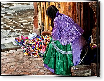 Dolls For Sale Canvas Print by Javier Barras