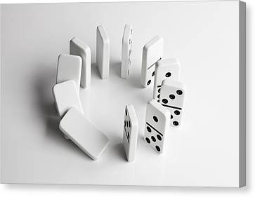 Balance In Life Canvas Print - Dominoes In A Circle Beginning To Fall Over In A Chain Reaction by Larry Washburn