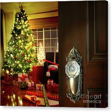 Door Opening Into A Christmas Living Room Canvas Print by Sandra Cunningham