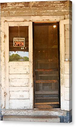 Door To A Country Store Canvas Print by Connie Fox