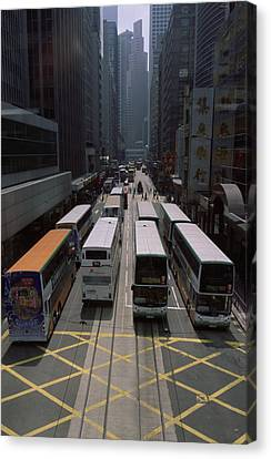Double Decker Buses In The Streets Canvas Print by Justin Guariglia