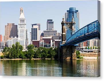Downtown Cincinnati Skyline And Roebling Bridge Canvas Print by Paul Velgos