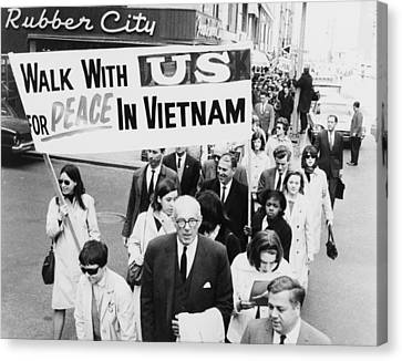 Dr. Benjamin Spock Leading A March Canvas Print by Everett