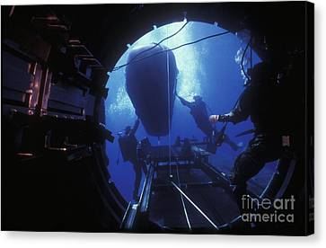 Dry Deck Shelter Crewmen Launch A Seal Canvas Print by Michael Wood