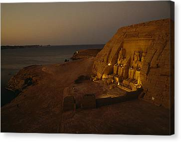 Dusk Descends On Abu Simbel With Lake Canvas Print by O. Louis Mazzatenta