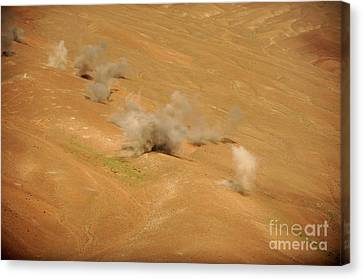 Dust Rises From The Impact Points Of Kp Canvas Print by Stocktrek Images