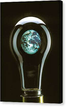 Earth In Light Bulb  Canvas Print by Garry Gay