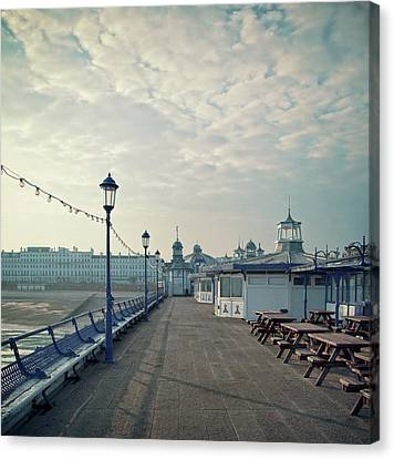 Eastbourne Pier Promenade Canvas Print by Paul Grand Image