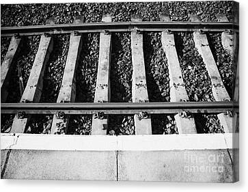 Edge Of Railway Station Platform And Track Northern Ireland Uk Canvas Print by Joe Fox