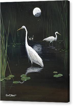 Egrets In The Moonlight Canvas Print by Kevin Brant