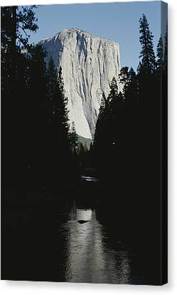 El Capitan Soars Above The Merced River Canvas Print by Marc Moritsch