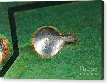 Electronics Board Solder Joint Canvas Print by Ted Kinsman