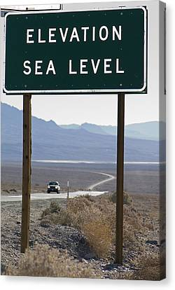 Elevation Sea Level Sign And Highway Canvas Print by Rich Reid