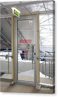 Emergency Exit At An Airport Canvas Print by Jaak Nilson