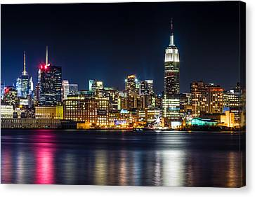Empire State Building And Midtown Manhattan At Night Canvas Print by Val Black Russian Tourchin