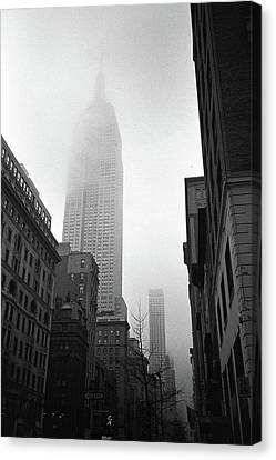 Empire State Building In Fog Canvas Print by Adam Garelick