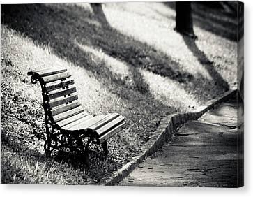 Empty Park Bench On Edge Canvas Print by (c) Conrado Tramontini