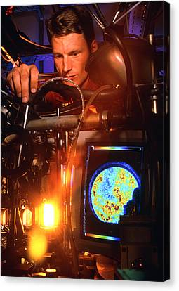 Engineer Researches Car Engine Combustion Canvas Print by Volker Steger