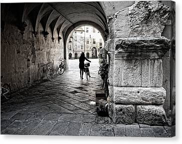Entry Of The Cyclist Canvas Print by Michael Avory