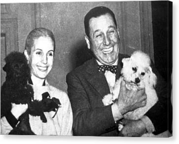 Eva And Juan Peron With Their Dogs Canvas Print by Everett
