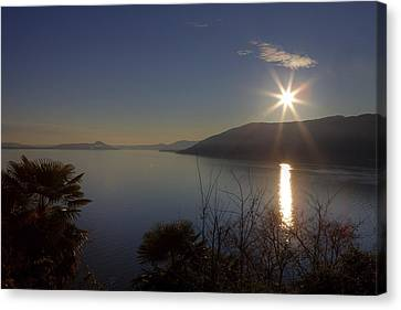 evening sun over the Lake Maggiore Canvas Print by Joana Kruse