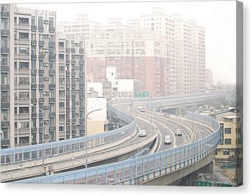 Expressway Through City Canvas Print by Lawren