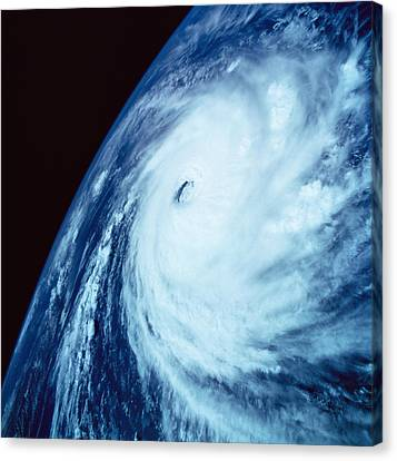 Eye Of A Storm Over Earth Viewed From Space Canvas Print by Stockbyte