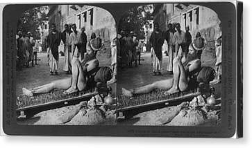 Fakir On His Bed Of Spikes Canvas Print by Everett