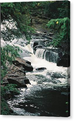 Falls On Presque Isle River Canvas Print by C E McConnell