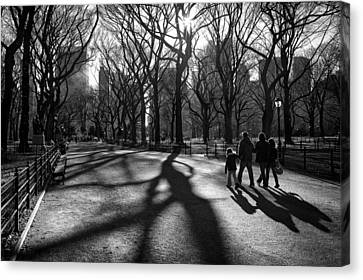 Family At Central Park In New York City Canvas Print by Ilker Goksen
