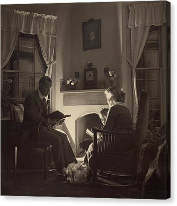Family Reads At The Fireside. 1935 Canvas Print by Everett